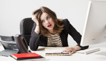 Business owner surrounded by too much work